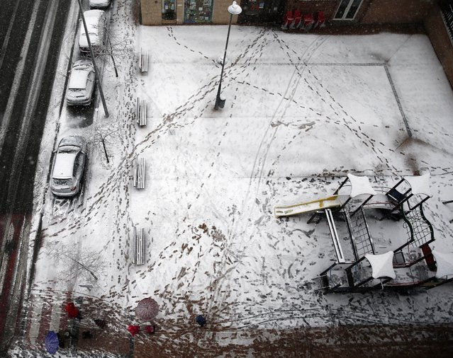 General view of a snow-covered children's playground during heavy snowfall in Huarte, Navarra, Spain, 01 December 2017. The Spanish territory is experiencing a polar cold spell with a general fall of temperatures and the first autumn's snowfalls in many northern regions. (Photo by Jesus Diges/EPA/EFE)