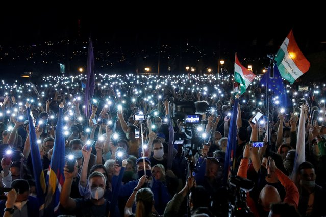 People light up their cell phones as they take part in a protest for media freedom after the editor-in-chief of Index, Hungary's leading independent news website was fired, near the Sandor Palace, in Budapest, Hungary, July 24, 2020. (Photo by Bernadett Szabo/Reuters)