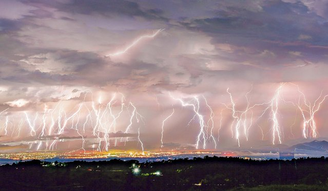 "Composite picture of lightning strikes over Colima, Mexico in just 5 minutes on July 14, 2020. These incredible photos show over 50 forks of lightning striking a city in just five minutes – in a storm being dubbed ""The Night of a Thousand Forks"". The amazing, panoramic photos over the valley shows the whole sky light up as the forks of lightning strike at different points along the length of the city's 165 square miles. (Photo by South West News Service/Action Press)"