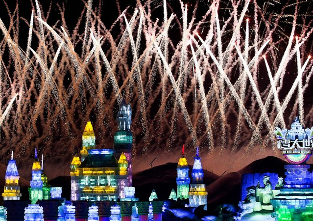 Fireworks explode over ice sculptures during the official opening of the 29th Harbin International Ice and Snow Festival on January 5, 2013. (Photo by Associated Press)