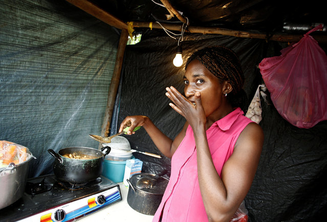 An African migrants stranded in Costa Rica tastes food at a makeshift camp at the border between Costa Rica and Nicaragua, in Penas Blancas, Costa Rica, September 7, 2016. (Photo by Juan Carlos Ulate/Reuters)