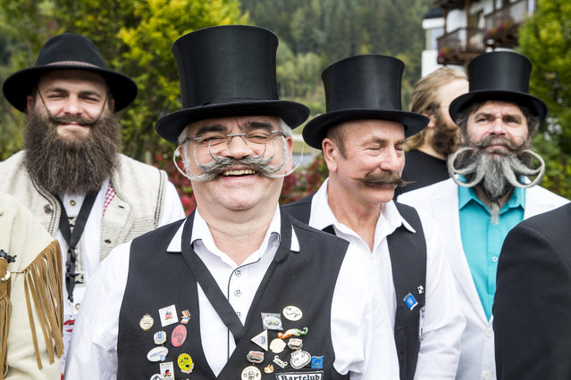 Contestants of the World Beard And Mustache Championships pose for a picture during the opening ceremony of the Championships 2015 on October 3, 2015 in Leogang, Austria. Over 300 contestants in teams from across the globe have come to compete in sixteen different categories in three groups: mustache, partial beard and full beard. The event takes place every few years at different locations worldwide. (Photo by Jan Hetfleisch/Getty Images)