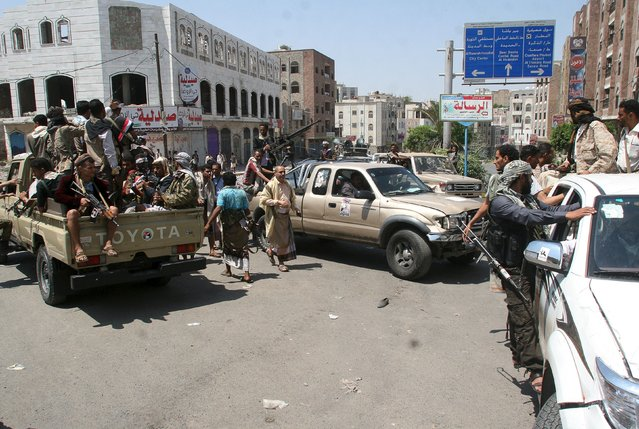 Fighters of the Popular Resistance Committees ride in trucks after a graduation ceremony of the affiliate special forces of the Popular Resistance, in Yemen's southwestern city of Taiz October 8, 2015. (Photo by Reuters/Stringer)