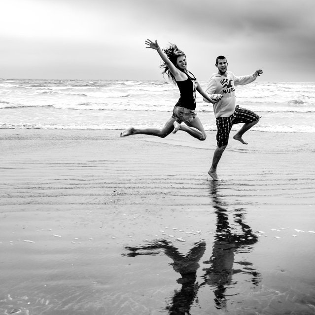 """Jumpology"". ""The runaway bride and groom"". (Photo by Andy Teo)"