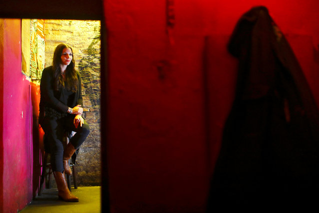 """Nico, a bouncer at Bassy Club, poses for a picture in Berlin, Germany, September 2, 2016. Nico is not only head bouncer at this club, where the motto for music is """"strictly before 1969"""", she is also an artist. (Photo by Hannibal Hanschke/Reuters)"""