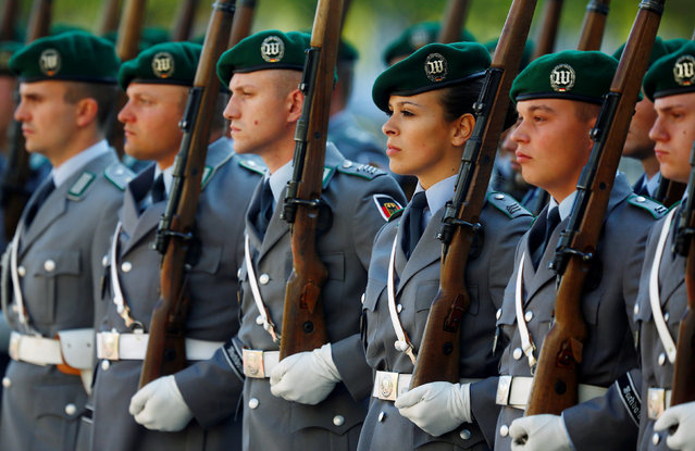 A female soldier of the honour guard stands in the line with male comrades during a welcoming ceremony at the chancellery in Berlin, Germany September 27, 2016. (Photo by Hannibal Hanschke/Reuters)