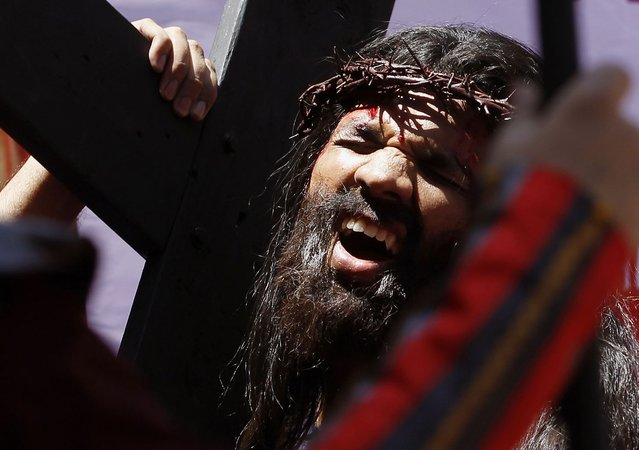 An India Christian devotee reenacts the sufferings of Jesus Christ on the occasion of Good Friday in Mumbai, India, Friday, March 29, 2013. Christians all over the world are marking Good Friday, the day when Christ was crucified. (Photo by Rajanish Kakade/AP Photo)