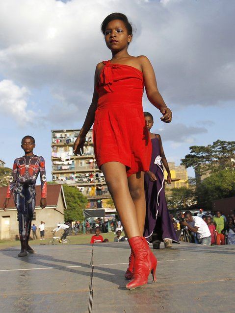 "A model catwalks during the Miss Koch beauty and talent pageant titled ""Getting to Zero Teenage Pregnancy"", at the Korogocho slums in Nairobi, December 6, 2014. (Photo by Thomas Mukoya/Reuters)"
