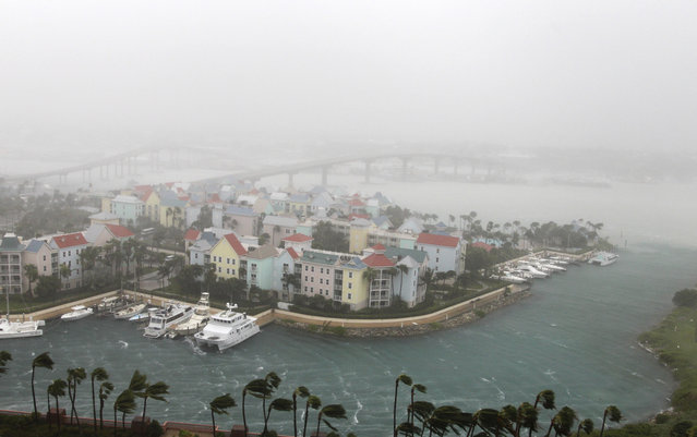 Hurricane Matthew moves through Paradise Island in Nassau, Bahamas, Thursday, October 6, 2016. The head of the Bahamas National Emergency Management Authority, Capt. Stephen Russell, said there were many downed trees and power lines, but no reports of casualties. (Photo by Tim Aylen/AP Photo)