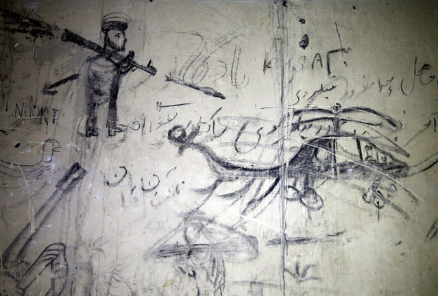 Graffiti (L) shows an armed man shooting a helicopter on a wall inside the ruined Darul Aman palace in Kabul, Afghanistan October 2, 2016. (Photo by Mohammad Ismail/Reuters)