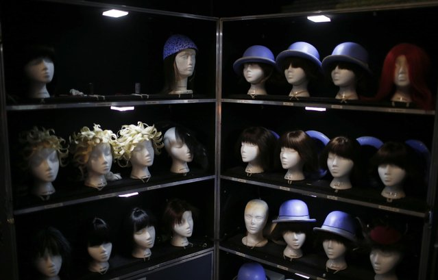 "Wigs and hats are seen backstage before Cirque du Soleil's show ""Quidam"", at the MEO Arena in Lisbon December 18, 2014. (Photo by Rafael Marchante/Reuters)"