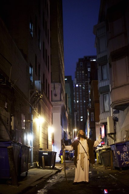 "Michael Grant, 28, ""Philly Jesus"", poses for a portrait in Philadelphia, PA alleyway on December 14, 2014. (Photo by Mark Makela/Reuters)"