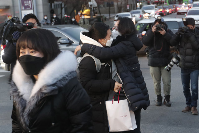 A student hugs her mother, right, before entering a high school to take the college entrance exam in Seoul, South Korea, Thursday, December 3, 2020. (Photo by Ahn Young-joon/AP Photo)