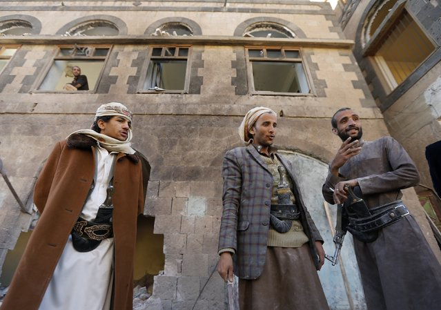 Members of the Shi'ite Muslim Houthi movement stand outside a building belonging to the movement after a blast, in Sanaa January 5, 2015. A large blast damaged a building belonging to Yemen's Shi'ite Muslim Houthi militia in a western district of the capital Sanaa early on Monday, but there were no fatalities, a police source and witnesses said. (Photo by Khaled Abdullah/Reuters)