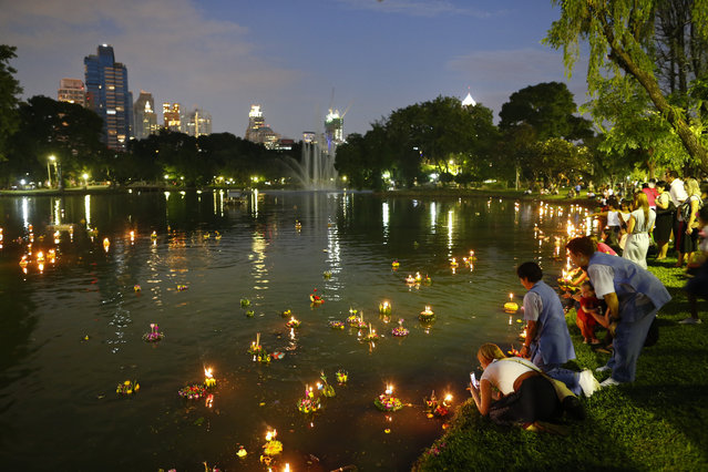 People float krathongs at a lake in a park on the Thai annual Loy Krathong festival, in Bangkok, Thailand, Wednesday, November 25, 2015. (Photo by Diego Azubel/EPA)