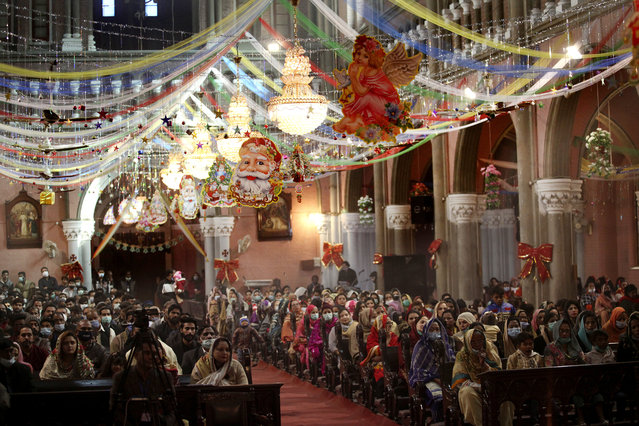 Christians attend a Christmas mass in Sacred Heart Cathedral in Lahore, Pakistan, Friday, December 25, 2020. (Photo by K.M. Chaudary/AP Photo)