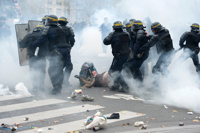 A demonstrator is arrested by the riot police during the forbidden COP21 demonstration on November 29, 2015 in Paris, France. The demonstration was banned after the Paris terror attacks on Friday, November 13th. Nevertheless, thousands of people gathered to protest against global warming ahead of COP21 and an estimated 100 people were arrested after fighting with police. (Photo by Aurelien Meunier/Getty Images)