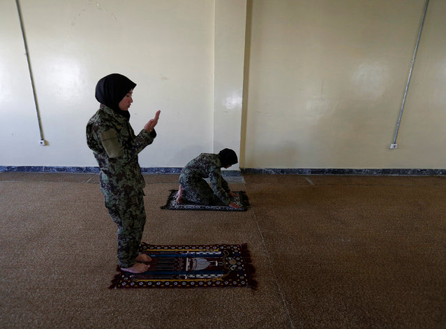 Female soldier Aghama Dehqanyar, 19 (L), prays inside a mosque at the Kabul Military Training Centre (KMTC) in Kabul, Afghanistan October 26, 2016. (Photo by Mohammad Ismail/Reuters)
