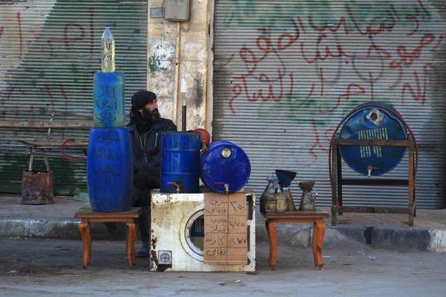 A man sells fuel in Idlib, Syria December 6, 2015. (Photo by Ammar Abdullah/Reuters)