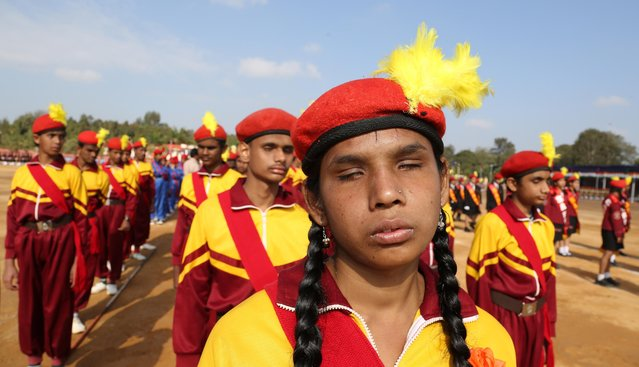 Visually impaired students wait to take part in full dress rehearsals of the Republic Day parade in Bangalore, India, Saturday, January 24, 2015. (Photo by Aijaz Rahi/AP Photo)
