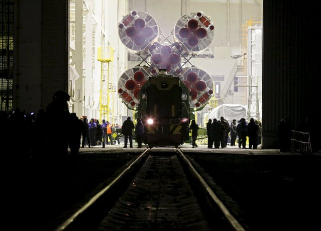 The Soyuz TMA-19M is transported from an assembling hangar to its launchpad at the Baikonur cosmodrome, Kazakhstan, December 13, 2015. The Soyuz is scheduled to travel with the crew of Timothy Kopra of the U.S., Yuri Malenchenko of Russia and Timothy Peake of Britain to the International Space Station (ISS) on December 15. (Photo by Shamil Zhumatov/Reuters)