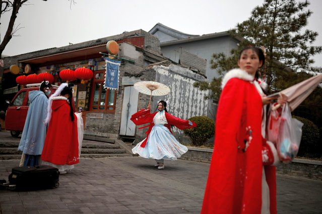 Women are dressed in traditional hanfu dresses in a historic part of Beijing as China celebrates Lunar New Year of the Ox following an outbreak of the coronavirus disease (COVID-19), China, February 14, 2021. (Photo by Thomas Peter/Reuters)
