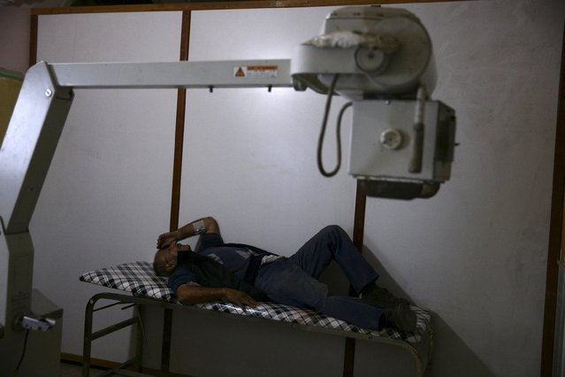 An injured man rests inside a field hospital, after what activists said was shelling by forces loyal to Syria's President Bashar al-Assad in the Douma neighborhood of Damascus, Syria December 2, 2015. (Photo by Bassam Khabieh/Reuters)