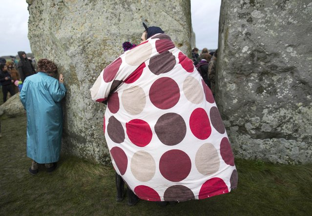 Revellers carry their duvet as they celebrate the winter solstice at Stonehenge on Salisbury Plain in southern England December 22, 2015. (Photo by Kieran Doherty/Reuters)