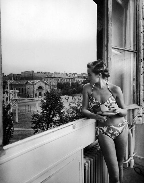 French fashion model Christiane Richard wears a bikini while drinking her morning coffee, 1950. (Photo by Nat Farbman/Time & Life Pictures/Getty Images)