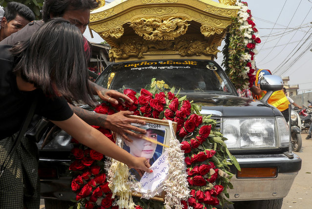 A hearse carrying the body of Saw Pyae Naing is driven in Mandalay, Myanmar, Sunday, March 14, 2021. Saw Pyae Naing, a 21-year old anti-coup protester was shot and killed by Myanmar security forces during a demonstration on Saturday, according to his family. (Photo by AP Photo/Stringer)
