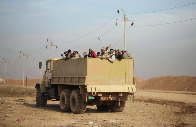 A military vehicle of the Iraqi army is pictured during an operation against Islamic State militants in the frontline neighbourhood of Intisar, eastern Mosul November 27, 2016. (Photo by Mohammed Salem/Reuters)