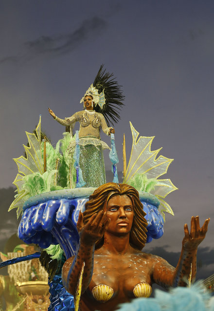 A dancer from the Nene de Vila Matilde samba school performs on a float during a carnival parade in Sao Paulo, Brazil, Saturday, February 14, 2015. (Photo by Andre Penner/AP Photo)