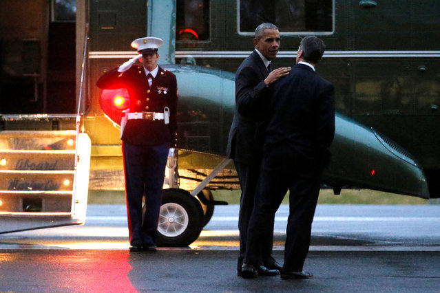 U.S. President Barack Obama (C) speaks with his physician Ronny Jackson (R) as he departs after visiting wounded members of the military at Walter Reed National Military Medical Center in Bethesda, Maryland, U.S. November 29, 2016. (Photo by Jonathan Ernst/Reuters)