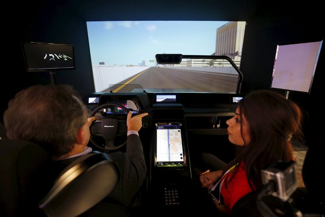 Mark Bridgwater and Zohra Hasta ride in a Pioneer In-Vehicle Context Awareness simulator during the 2016 CES trade show in Las Vegas, Nevada January 8, 2016. The simulator features a variety of technologies including a wake-up fragrance sprayed from the dash when biometric sensors in the driver's seat detect driver fatigue. (Photo by Steve Marcus/Reuters)