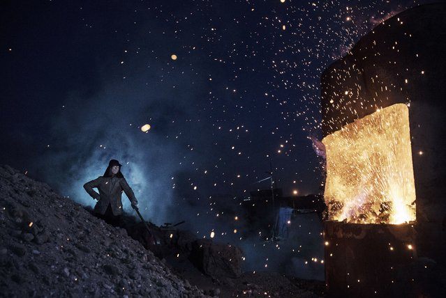 "A Chinese labourer stands near a furnace as he works at an unauthorized steel factory on November 3, 2016 in Inner Mongolia, China. To meet China's targets to slash emissions of carbon dioxide, authorities are pushing to shut down privately owned steel, coal, and other high-polluting factories scattered across rural areas. In many cases, factory owners say they pay informal 'fines' to local inspectors and then re-open. The enforcement comes as the future of U.S. support for the 2015 Paris Agreement is in question, leaving China poised as an unlikely leader in the international effort against climate change. U.S. president-elect Donald Trump has sent mixed signals about whether he will withdraw the U.S. from commitments to curb greenhouse gases that, according to scientists, are causing the earth's temperature to rise. Trump once declared that the concept of global warming was ""created"" by China in order to hurt U.S. manufacturing. China's leadership has stated that any change in U.S. climate policy will not affect its commitment to implement the climate action plan. While the world's biggest polluter, China is also a global leader in establishing renewable energy sources such as wind and solar power. (Photo by Kevin Frayer/Getty Images)"