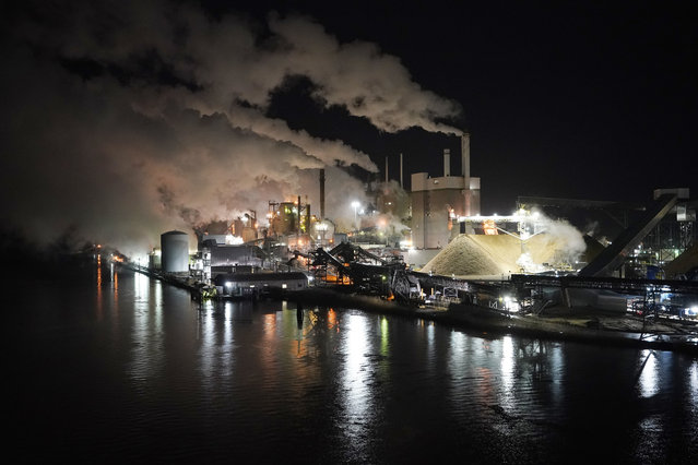 Smoke and steam rise up from the Westrock paper plant along the Pamunkey river in West Point, Va., Friday, February 26, 2021. The mill was opened by the Chesapeake Corporation in 1914. (Photo by Steve Helber/AP Photo)