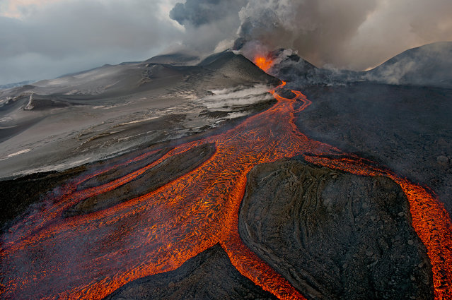 """Russia: """"The cauldron"""". On 29 November 2012, Sergey received the call that he had long hoped for. Plosky Tolbachik – one of two volcanoes in the Tolbachik volcanic plateau in central Kamchatka, Russia – had begun to erupt. """"I've gone to the area many times, but it had been 36 years since the last eruption"""", he says. """"So I dropped everything and went"""". (Photo by Sergey Gorshkov/Wildlife Photographer of the Year 2013)"""