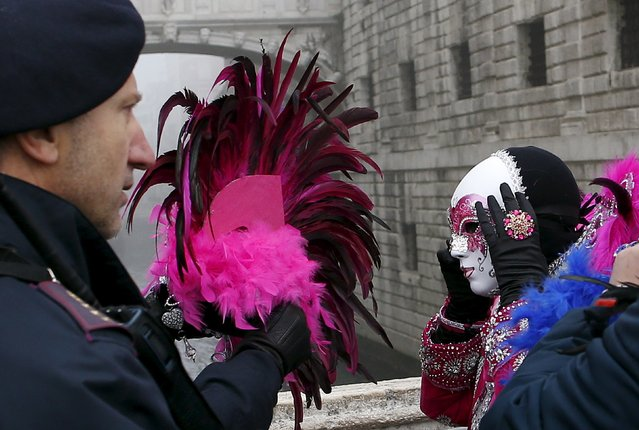 Italian policemen check masked revellers as they arrive at San Marco Piazza during the Venice Carnival, January 31, 2016. (Photo by Alessandro Bianchi/Reuters)