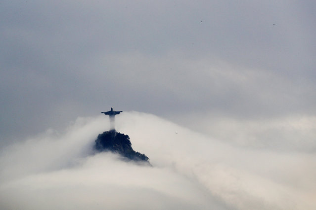BRAZIL: Clouds surround the Christ the Redeemer statue over Rio de Janeiro, Brazil, August 9, 2016. (Photo by Brian Snyder/Reuters)