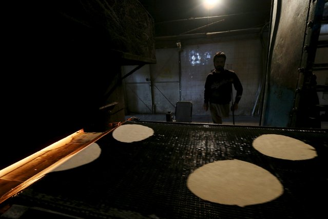 A man, whose leg was amputated, works inside a bakery in the Syrian town of Ras al-Ain, close to the Turkish border, January 23, 2016. (Photo by Rodi Said/Reuters)