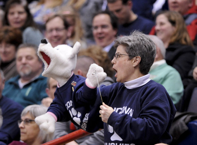 A Connecticut fan holds a puppet during the second half of a regional final game against Dayton in the NCAA women's college basketball tournament on Monday, March 30, 2015, in Albany, N.Y. (Photo by Tim Roske/AP Photo)