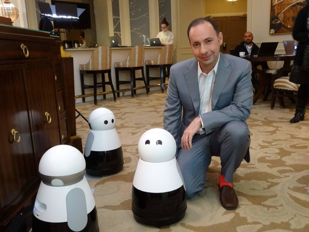 Mayfield Robotics CEO Michael Beebe poses  with his Kuri robot, launched at the 2017 Consumer Electronics Show in Las Vegas, Nevada on January 6, 2017. (Photo by Rob Lever/AFP Photo)