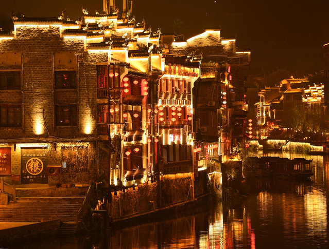 Lanterns hung on buildings beside the river in Zhenyuan's ancient city, Guizhou Province, China on January 15, 2019. (Photo by Xinhua News Agency/Rex Features/Shutterstock)