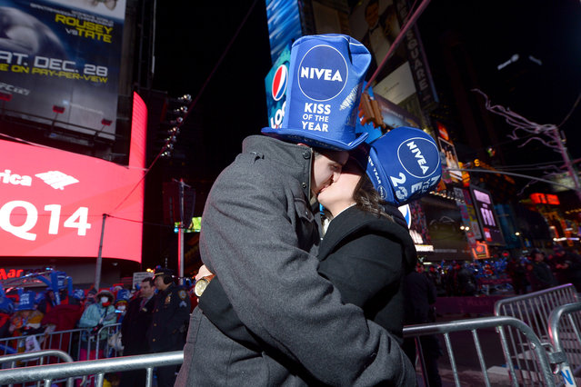 Zac Hihey surprises his girlfriend, Hannah Kanaan, with a proposal on the NIVEA Kiss Stage in Times Square on December 31, 2013 in New York City. (Photo by Michael Loccisano/Getty Images for Nivea)