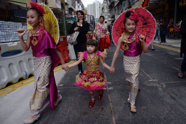 Children take part in a parade to celebrate the Songkran festival in Hong Kong on April 12, 2015. (Photo by Dale de la Rey/AFP Photo)