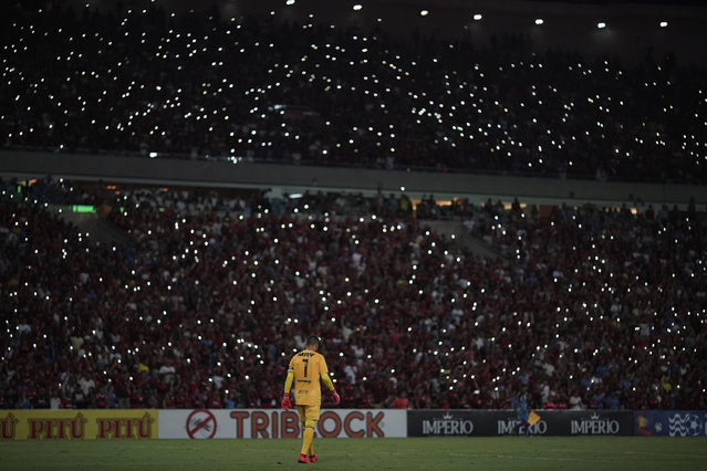 Flamengo's goalkeeper wears a jersey with the name of the young goalkeeper Christian, one of the 10 teenage players killed by a fire at the Flamengo training center last Friday, ahead of a soccer match between Flamengo and Fluminense, at the Maracana Stadium, in Rio de Janeiro, Brazil, Thursday, February 14, 2019. (Photo by Leo Correa/AP Photo)