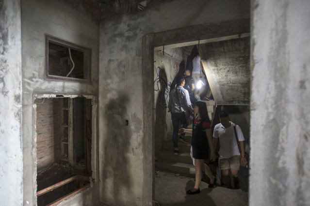Visitors walks up the fire escape inside an abandoned building in Bangkok April 19, 2015. (Photo by Athit Perawongmetha/Reuters)