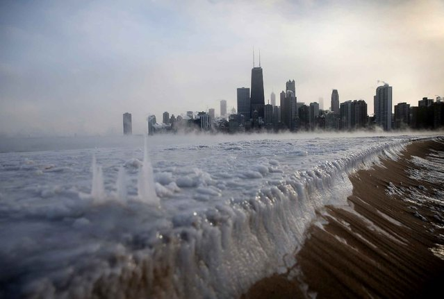 Ice builds up along Lake Michigan at North Avenue Beach as temperatures dipped well below zero on January 6, 2014 in Chicago, Illinois. Chicago hit a record low of -16 degree Fahrenheit this morning as a polar air mass brought the coldest temperatures in about two decades into the city. (Photo by Scott Olson/AFP Photo)