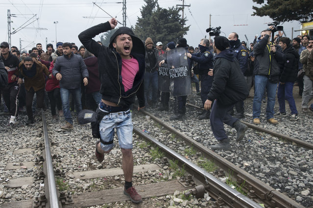 Refugees and migrants break through the Greek police cordon as they try to approach the Greek-Macedonian border, near the northern Greek village of Idomeni on Monday, February 29, 2016. Macedonian police fired tear gas and stun guns Monday as several hundred Iraqi and Syrian refugees, frustrated at days of delays in crossing the Greek-Macedonian border, broke down a gate on a nearby rail crossing. (Photo by Petros Giannakouris/AP Photo)