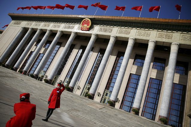 Hostesses pose for photos outside the Great Hall of the People where sessions of the National People's Congress (NPC) are taking place, in Beijing, China March 7, 2016. (Photo by Damir Sagolj/Reuters)